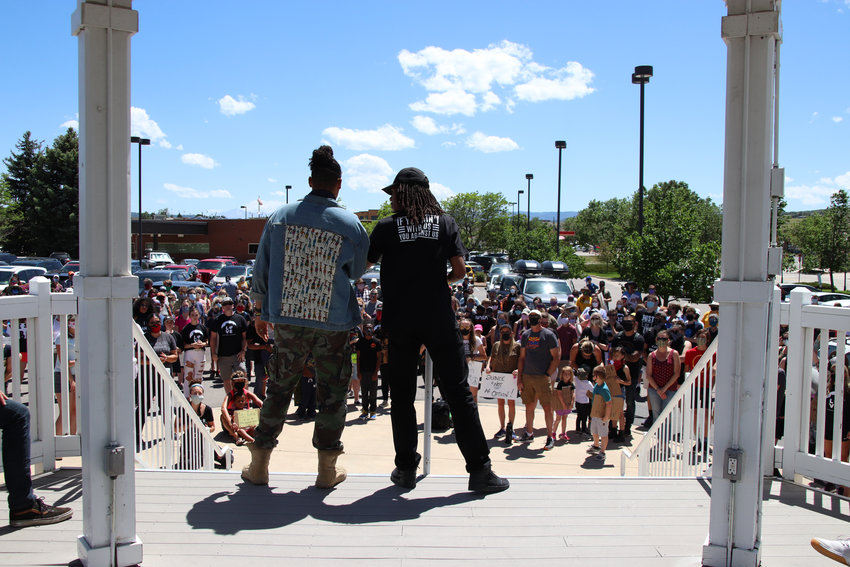Jourdan Henderson and Quincy Shannon speak to crowds at the June 7 protest in Castle Rock.