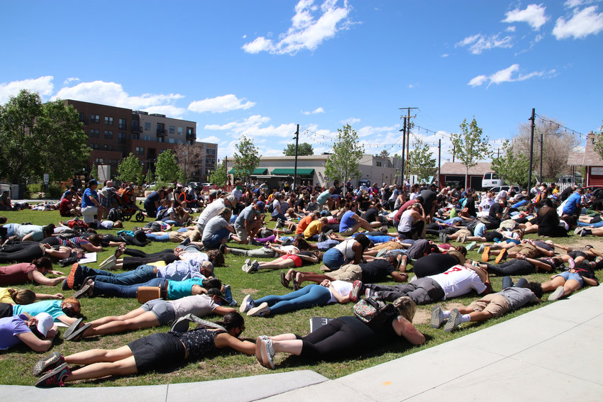 "Crowds filled festival park in protest on June 7, laying down for nine minutes chanting ""I can't breathe."""