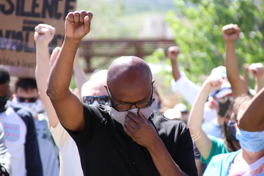 Protesters raise fists during June 7 demonstrations decrying racism in Castle Rock.