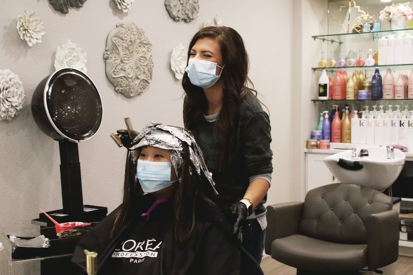 Roots and Mane salon in Lone Tree reopened May 14. The salon has taken social distancing measures and required stylists to wear masks.