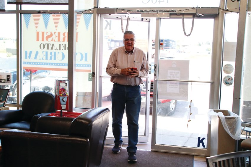 Ray Guth walks into his coffee shop on June 3 after checking on customers.