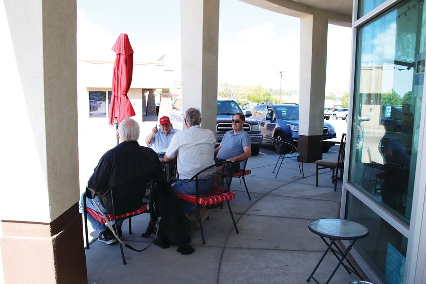 A group of men sit outside Briccy's Coffee shop on June 3.