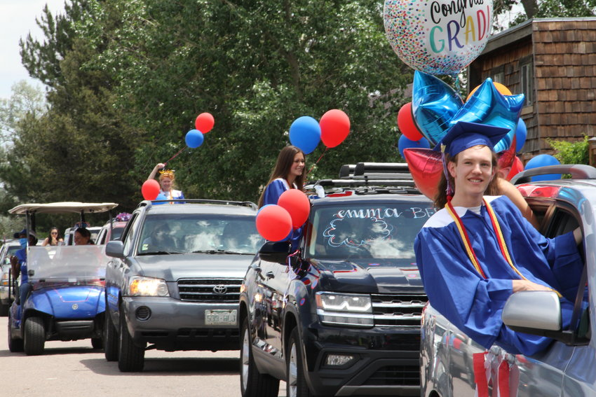 Hundreds of cars — many with balloons, words and other decorations adorning them — drove slowly past Cherry Creek High's staff members, who cheered them on.