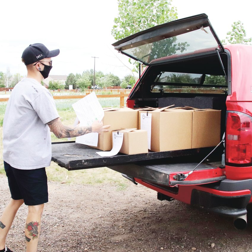 A delivery driver loads his car in preparation for his delivery route. Drivers can customize their route based on their own location and the size of their vehicle.