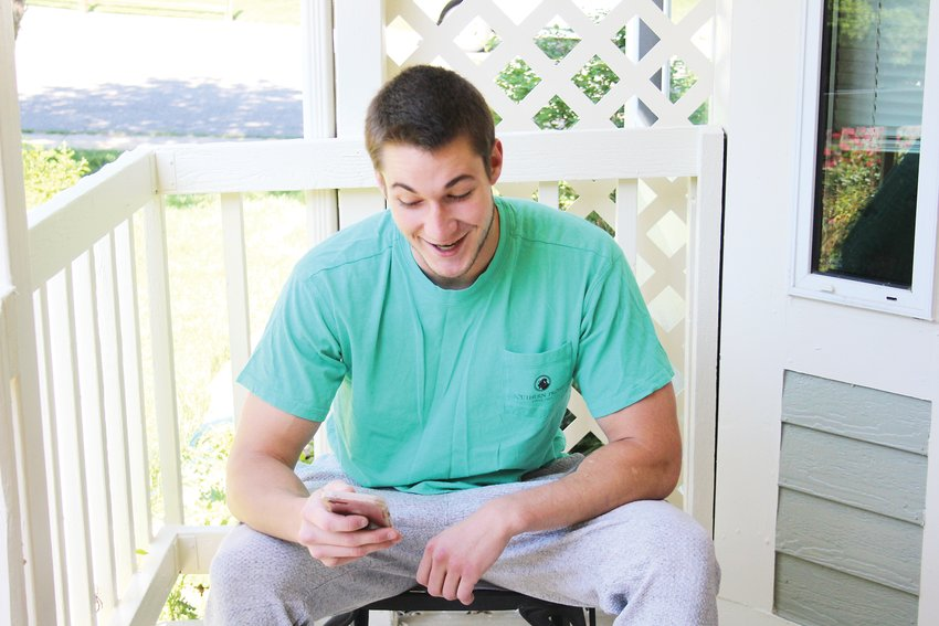 Townsend Wenzler swipes through the Bumble dating app outside his Arvada home on June 4. Dating apps like Bumble have reported that they have seen more users since the pandemic started.