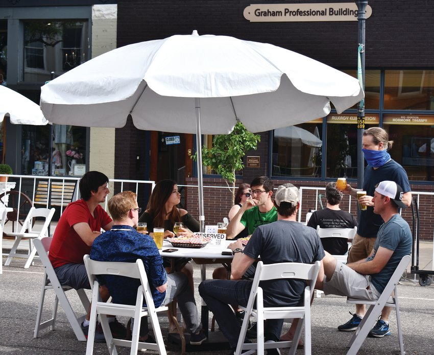 "Patrons of Jake's Brew Bar enjoy outdoor seating on Main Street in Littleton during the ""Weekends on Main"" outdoor event June 12."