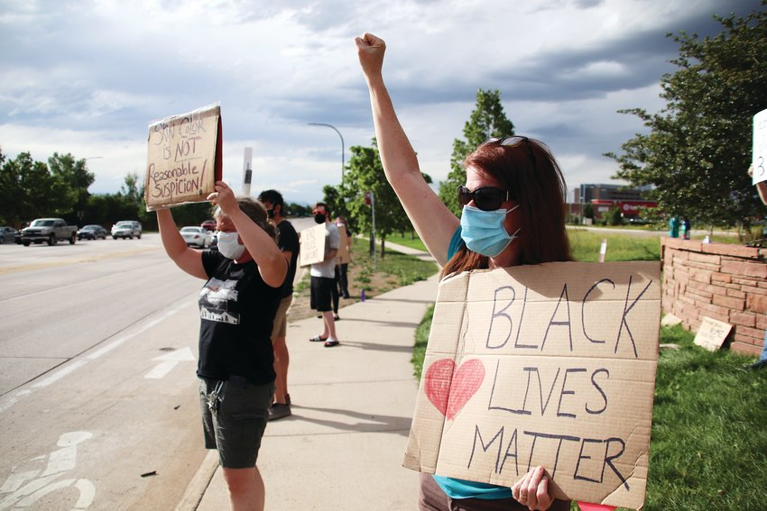 Kelly Mayr, left, and Amy Weeks have participated in multiple protests in Highlands Ranch supporting the Black Lives Matter movement since the death of George Floyd. Here, they are pictured at the corner of Lucent Boulevard and Highlands Ranch Parkway on June 8.