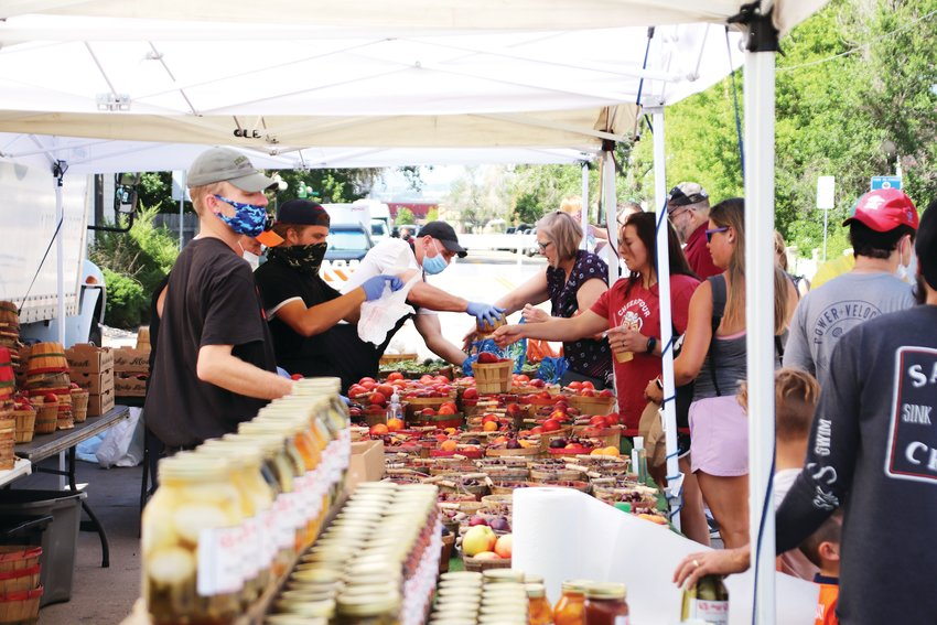 The Parker Farmers Market has been open since June 7 with some changes to accommodate social distancing practices. Most wore masks and people generally respected each other's space. Vendors handled their own produce and no in-person samples are allowed.