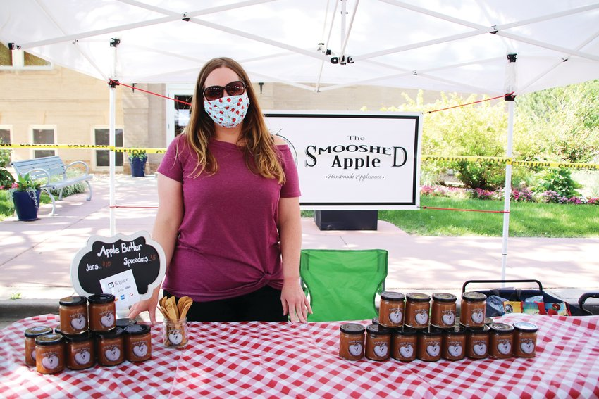 "Staci Mann, of Parker, can't provide samples of her apple butter at this year's farmer's market, but she said it hasn't interfered with her business, the Smooshed Apple, so far. ""I've had people ask for samples, but people that know they like the product or apple butter in general, they just want to buy anyway without sampling."" Mann sells various products at farmer's markets and festivals and said though her business selling apple butter and lollipops hasn't dipped, the mass cancellation of summer festivals has hurt her business selling art prints. ""A festival, where I'll make a month's worth of income in a day--so I have to account for that loss of income."""