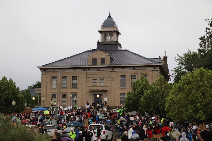 People gather on the lawn of the Littleton Municipal Courthouse as part of the Black Lives Matter Solidarity Walk on June 18. Hundreds of people attended, including much of the city council and school board.