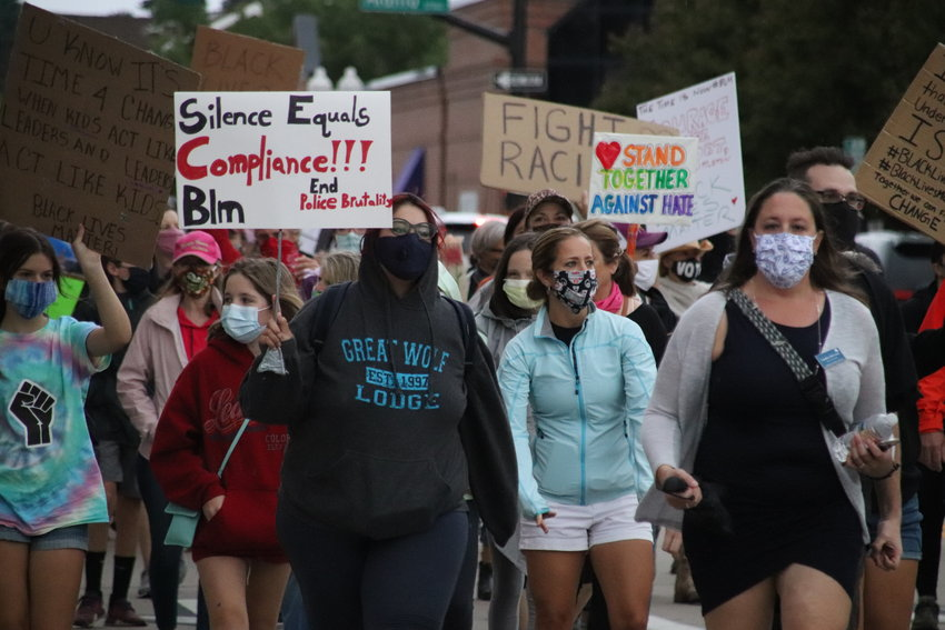 Marchers walk toward the Littleton Municipal Courthouse as part of the Black Lives Matter Solidarity Walk on June 18.