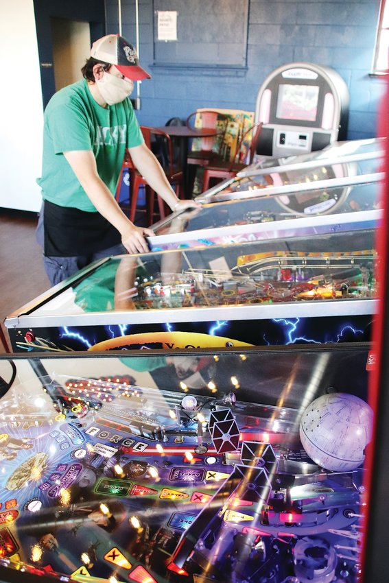 Colorado Pinball Pub co-owner Dan Nikolich takes a break to play a game.