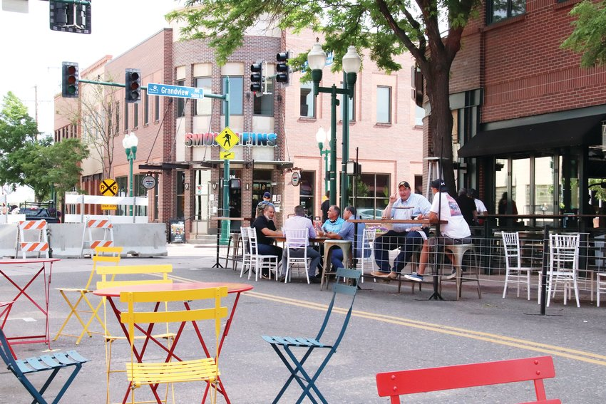 Customers take advantage of expanded seating at the intersection of Grandview Avenue and Olde Wadsworth Boulevard.