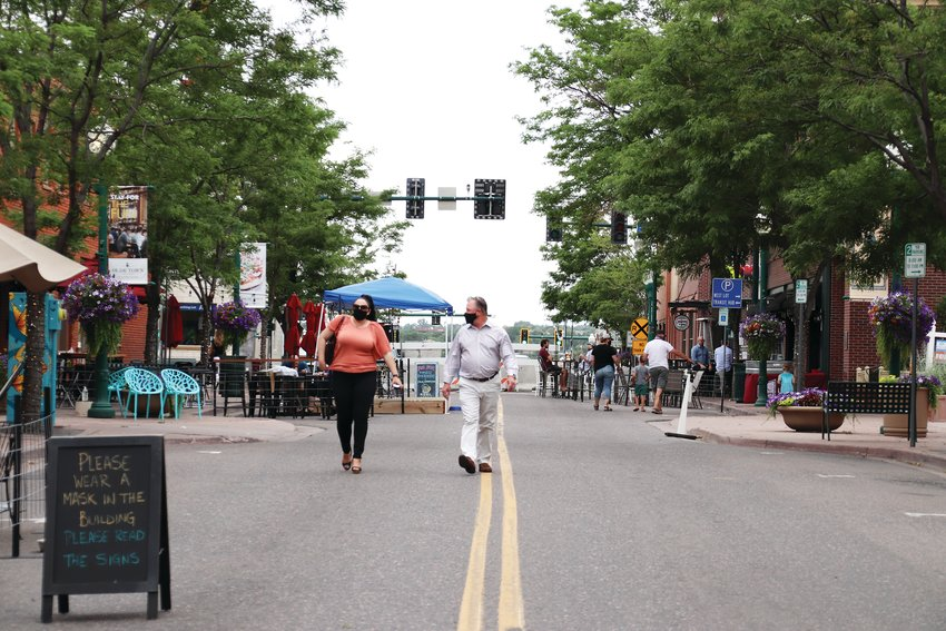 Residents stroll down Olde Wadsworth June 18.