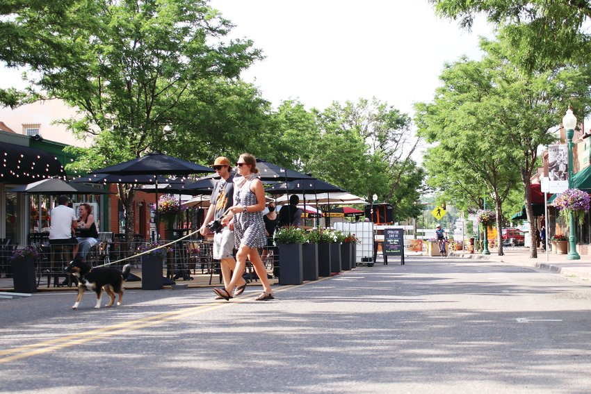 Residents on Olde Wadsworth Blvd near Arvada Tavern on June 15, three days after a portion of the street and a portion of Grandview Avenue were closed for the summer to allow restaurants to expand their patios and encourage social distancing for pedestrians.