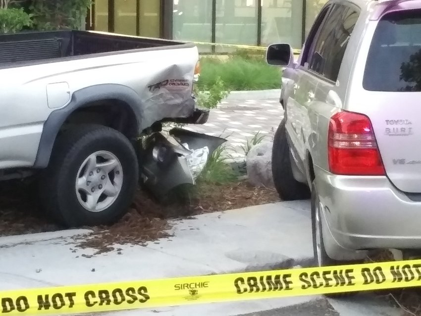 Damage after a car crash at Englewood Police Department headquarters.