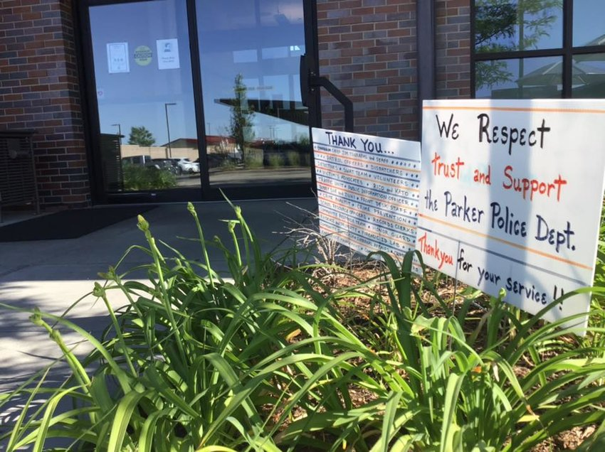 Parker residents left signs of support outside the Parker Police Department.