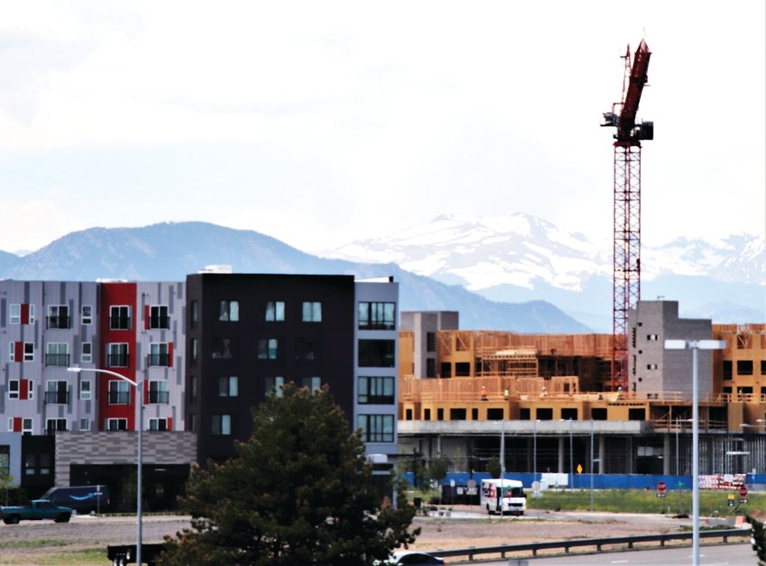 A construction crane towers over Downtown Westminster, part of the 226-unit Aspire Westminster housing development. Work on several projects in the area have continued during the COVID-19 shutdowns, but some projects have been delayed a few weeks.
