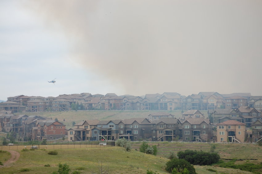 Smoke billows above homes in the BackCountry neighborhood of Highlands Ranch at about 2 p.m. June 29, 2020, as firefighters worked to contain the 267-acre blaze that forced mandatory evacuations from the subdivision. Haze from the wildfire spread throughout the area near Wildcat Reserve Parkway and Gateway Drive, near the subdivision's entrance.