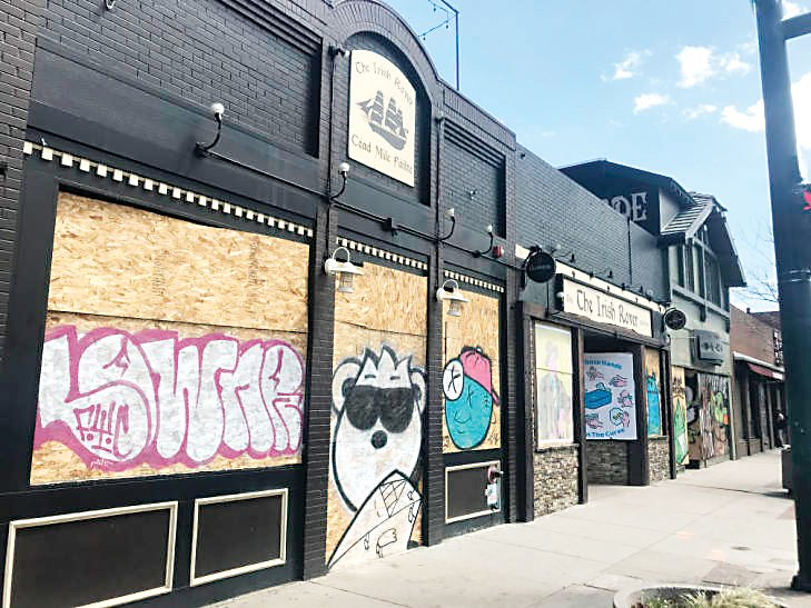 This image of graffiti-style lettering and cartoon figures that have been painted on the windows of the Irish Rover bar on South Broadway has been added to the library's collection of images documenting COVID-19's impact on the Denver area, which can be viewed online.