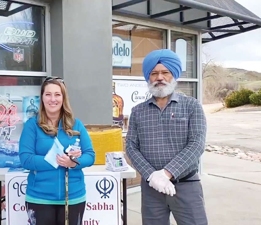 Lakhwant Singh is pictured at a mask, sanitizer and meal giveaway for health-care workers and first responders earlier this year at Two Angels Liquors, which Singh owns.