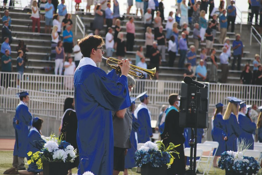 Legend High School senior Hayden Duncan plays the National Anthem on a trumpet during the school's belated commencement ceremony June 25.