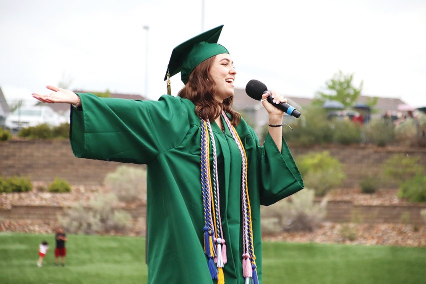 A Mountain Vista High School graduate sings during the June 26 graduation ceremony.