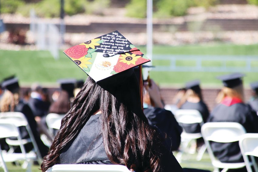 "A Castle View High School graduate wears a unique graduation cap showing flowers, the Mexican flag and a Spanish phrase: ""Me puse las pilas! El primer logro de muchos. Gracias mama y papa por sus sacrificios, effuerzos y apoyo."""