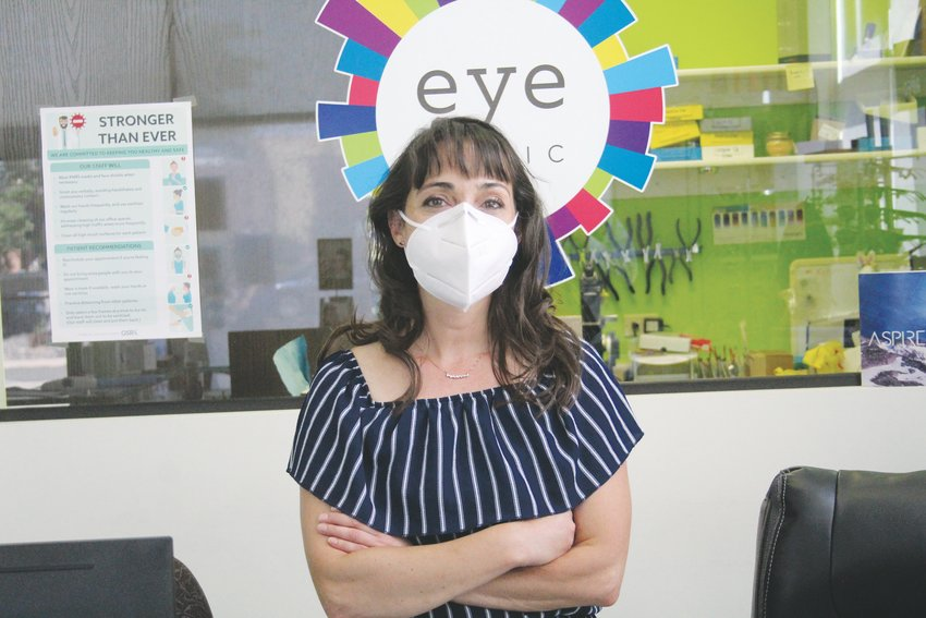 Amy Gallegos, owner of Eye Logic, poses for a photo on June 25. Gallegos is a member of a steering committee that is responsible for providing regular updates to Englewood City Council about the Downtown Matters Plan.