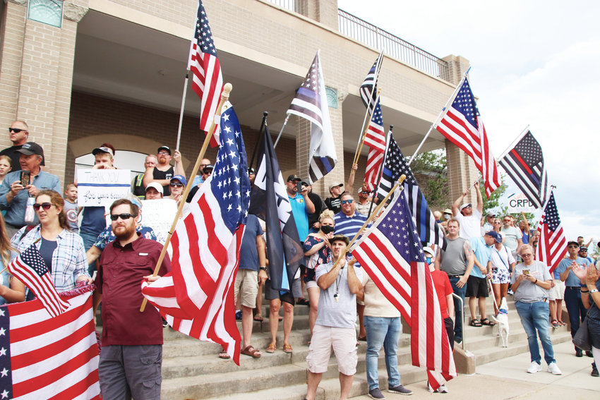 Crowds gathered on the steps of the Castle Rock Police Department after marching in the downtown.