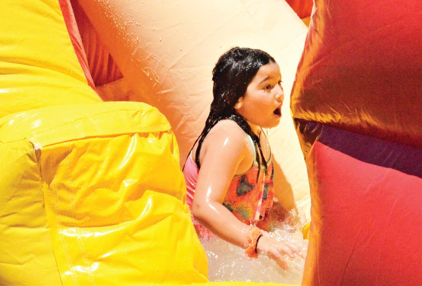 A Camp Gan Izzy camper reacts after a wet splash on the camp's water slide June 23 at Chabad of NW Metro Denver.