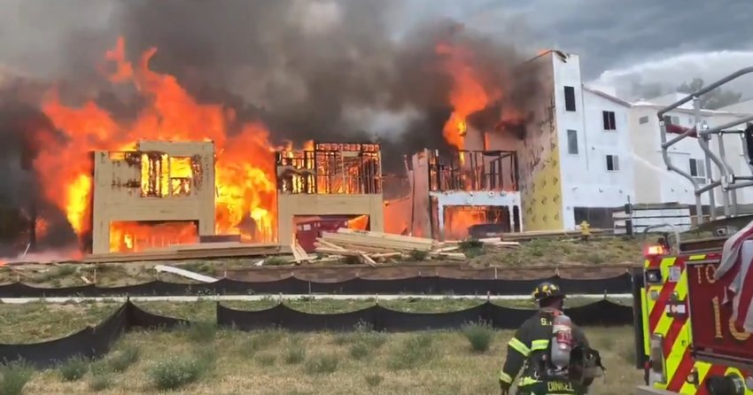 South Metro Fire Rescue crews battle a fire involving a series of woodframe buildings in Highlands Ranch on July 6, 2020.