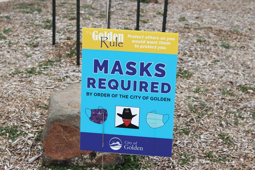 A new sign has been placed in Parfet Park to notify people that masks are required to be worn in the park. However, few people in the park were following the mandate on July 2.
