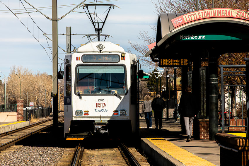 Passengers board an RTD light-rail train at the Littleton/Mineral station on Jan. 19, 2020.