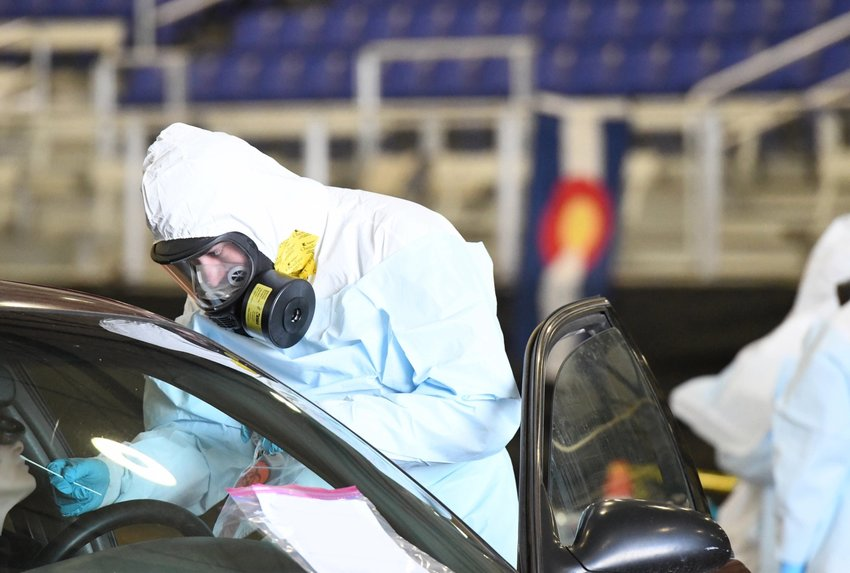 A worker at a coronavirus drive-up testing site in Montrose.