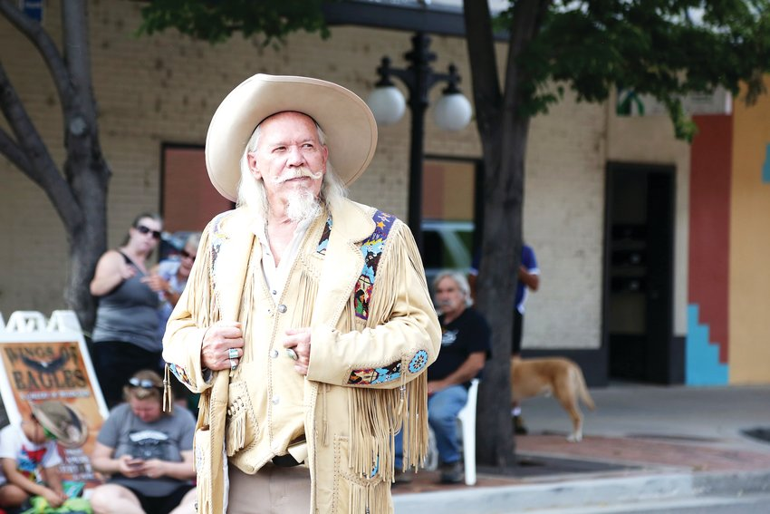 Buzz Baker stands by as the Buffalo Bill Days parade begins. He has been impersonating the festivals namesake for 15 years.