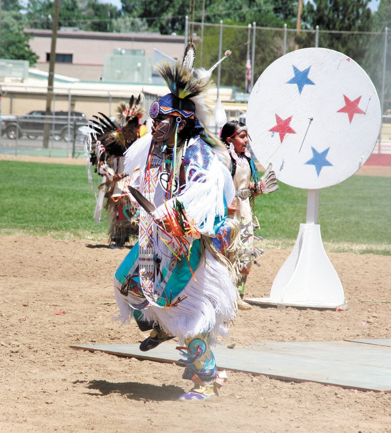A Native American dancer with the Northern Wind Dancers of Pueblo performs as part of Cody's Wild West re-enactment, during the Golden Buffalo Bill Days celebration in 2015.