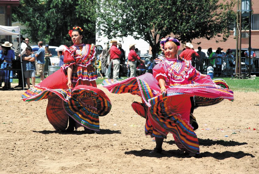 Two ladies, part of the Colorado Mestizo Dancers, perform a Mexican folk dance in traditional attire. The group, which consists of about six dancers of varying ages including girls no more than 10 years old, performed a couple of times during the Cody's Wild West re-enactment as far back as 2015.