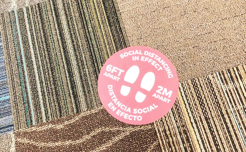 A social distancing decal on the floor of the newly reopened Golden Public Library.
