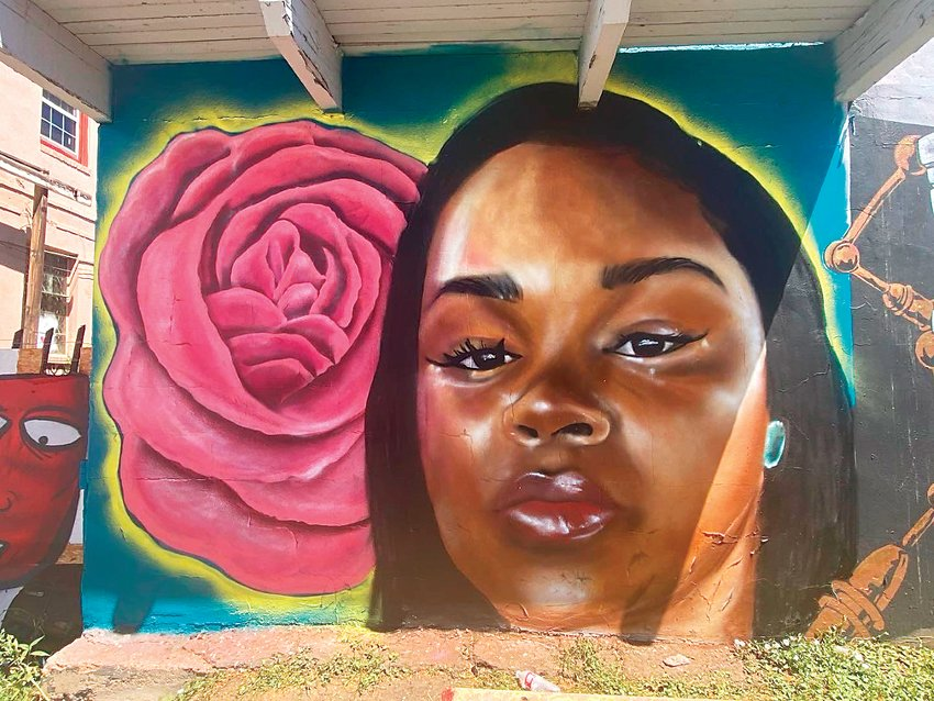 A mural of Breonna Taylor painted by Chelsea Lewinski at 6851 W. Colfax Ave. Taylor died in March after being shot by Louisville Police.