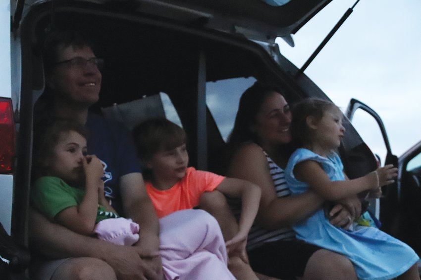 "From left, Eric Graham; Sylvia, 4; Elliott, 7; Dahlia, 4; and Rita Graham watch ""The Lion King"" at a July 16 drive-in movie event at the Cherry Creek Innovation Campus. The central Centennial-area event is one of the first-ever drive-in movies put on by the city. Centennial aimed to bring people together while adhering to public health restrictions."