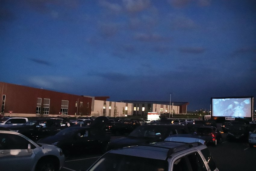 Dozens of vehicles came to the Cherry Creek Innovation Campus parking lot for a drive-in movie, a non-traditional Centennial event this summer. Many of Centennial's usual summer events have been canceled due to COVID-19 precautions.