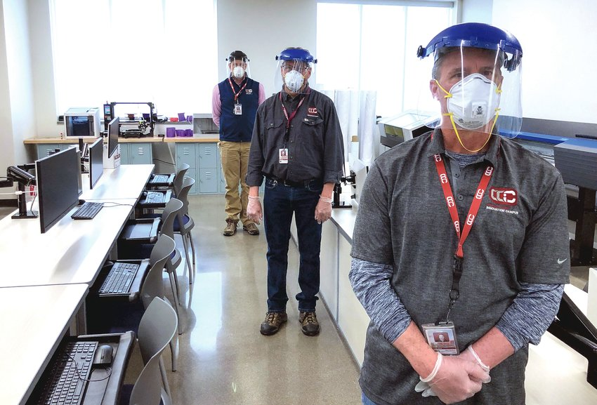 In an April 2020 file photo, personnel at the Cherry Creek Innovation Campus in Centennial personnel are seen wearing face masks and shields.