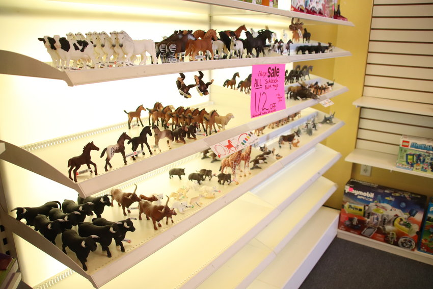 Miniature animal figurines on sale at Timbuk Toys in Highlands Ranch were marked down to half off in a closing sale July 23.