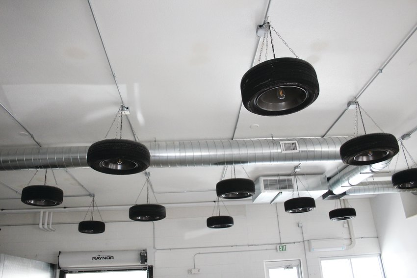 Tire lights hanging from the ceiling of Filling Station Tap House in Englewood. Andy Hawker used to work at a filling station and the decor inside the tap house reflects his past.