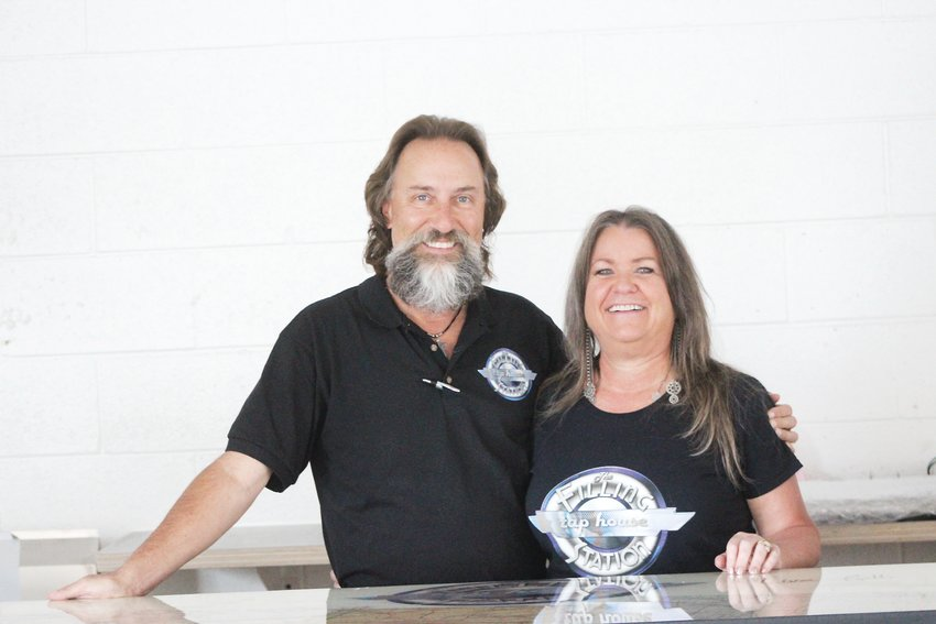 Andy and Lisa Hawker, owners of the Filling Station Tap House, pose for a photo. The couple has been planning to open the tap house for the past five years.