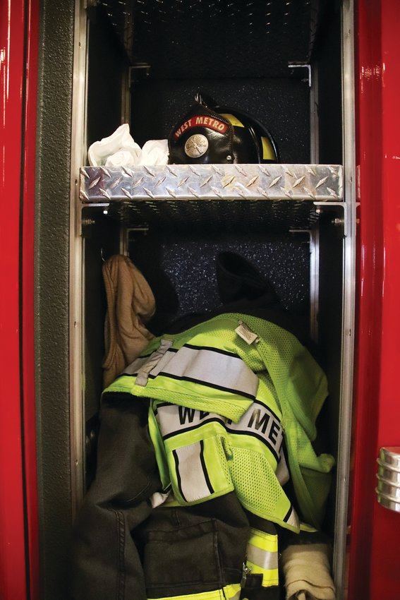 The inside of a locker on a West Metro Fire Rescue fire engine. Extra gear and personal protective equipment is kept inside.