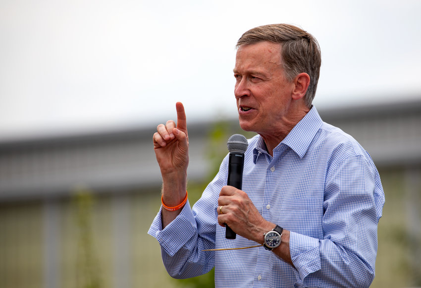 Then-presidential candidate John Hickenlooper greets supporters at the Iowa State Fair in Des Moines, Iowa, on Aug. 10, 2019.
