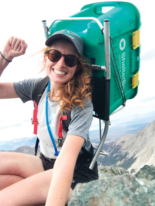 Brittney Woodrum, an outdoor enthusiast who has a passion for helping others, smiles as she summits Blanca Peak in the Sangre de Cristo Range. Woodrum, who is pursuing a master's degree at the University of Denver, is climbing all 58 of Colorado's 14,000-foot mountains to benefit ShelterBox USA, which is an international disaster relief organization.