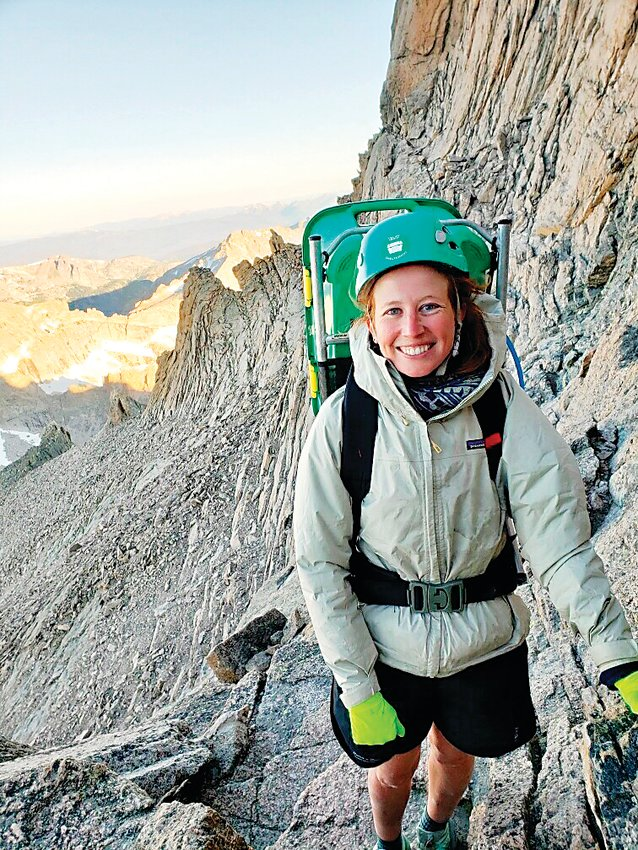 Woodrum pauses for a photo as she makes her way up Longs Peak. Woodrum is an outdoor enthusiast who has a passion for helping others.